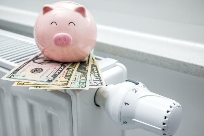 Heating home concept with money and piggy bank