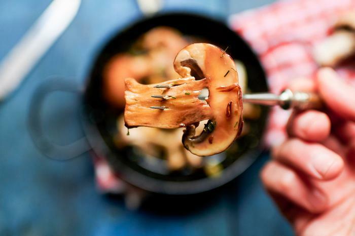 Mushroom slice on fork