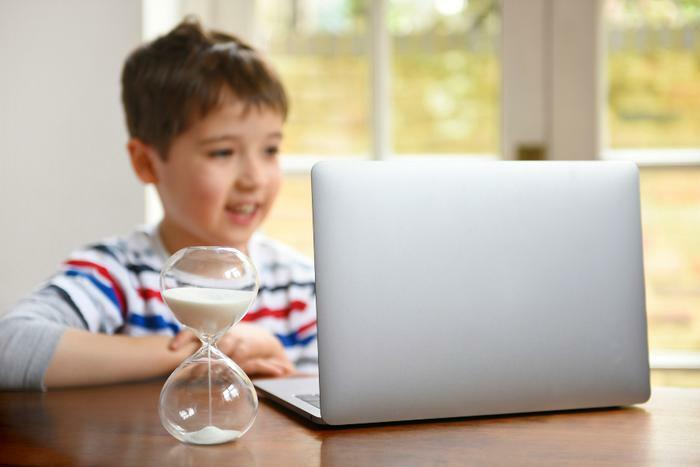 Screen time concept with child and laptop