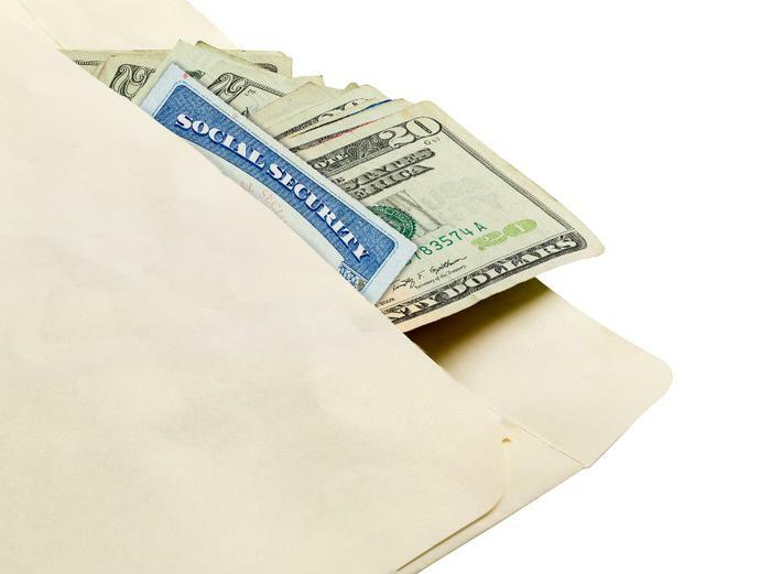 Social security card and money in envelope