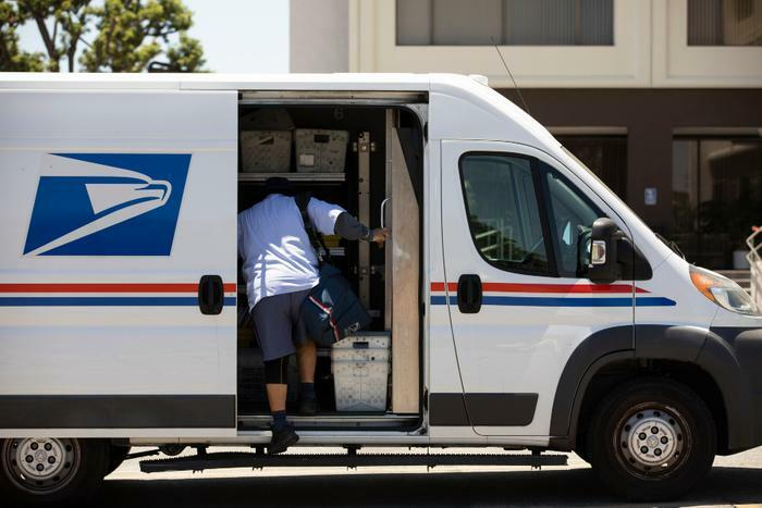 USPS mail delivery van and mailman