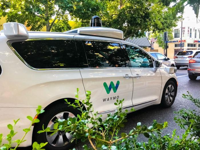 Waymo partners with Lyft to offer rides in self-driving minivans