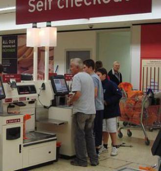 5defd8060bc It started in chain supermarkets. In one section of the check-out aisles  there suddenly appeared self-service scanners where consumers were  encouraged to ...