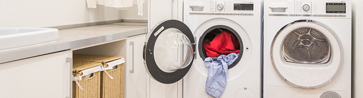 washer and dryer with clothes in the dryer