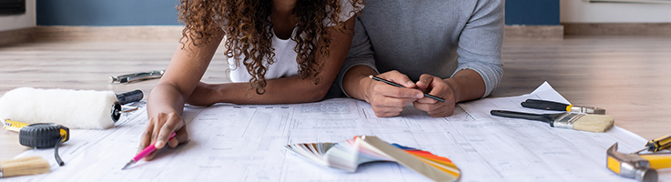 couple looking at house blueprints
