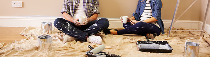 couple sitting on the floor during a home renovation