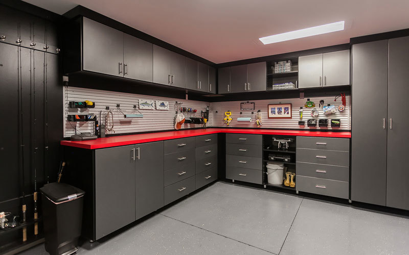 this flashy black melamine motor trend garage features an incredible custom work bench with red formica