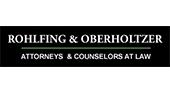 James Oberholtzer, Chartered logo