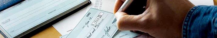 Man signing check