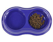 Photo: A pet's food and water bowl.