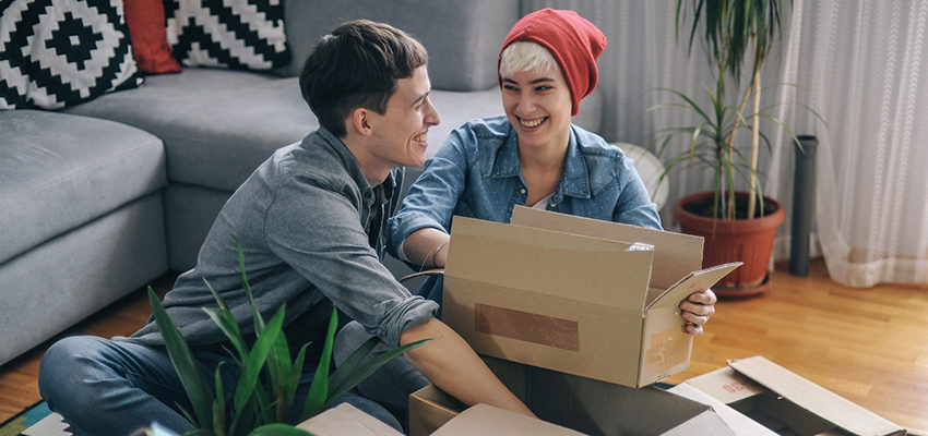 couple smiling while packing