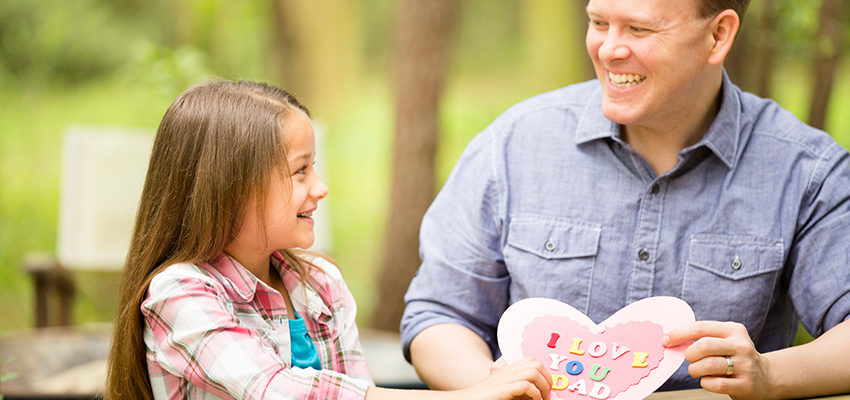 father daughter holding card