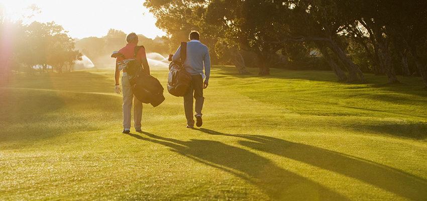 friends walking in golf course