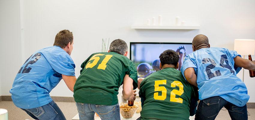 friends watching american football