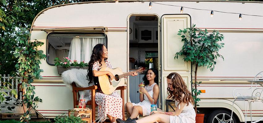 girls outside camper