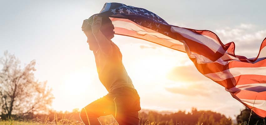 little boy running with american flag