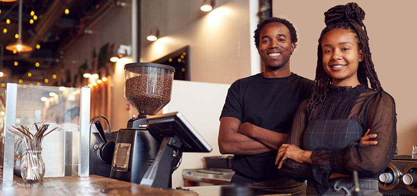 man and woman coffee shop owners smiling
