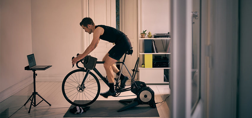 man working out on an exercise bike