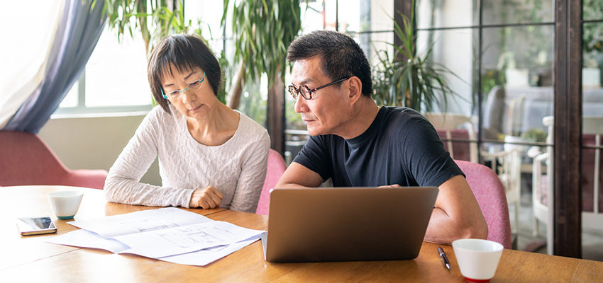 older couple doing tax documents