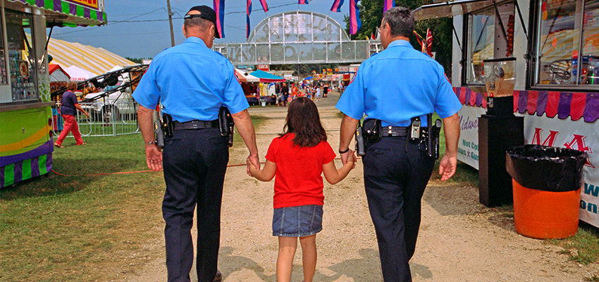 police officers helping little girl