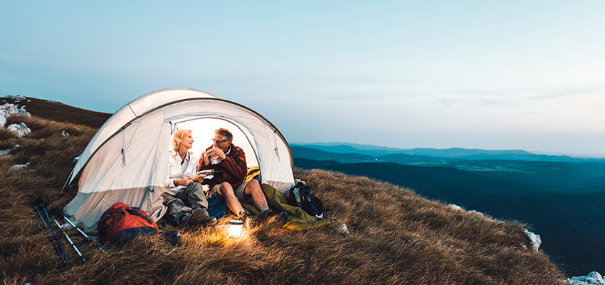 senior couple camping