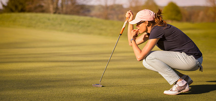 woman concetrating in golf