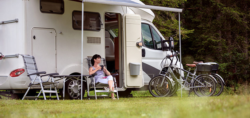 woman sitting outside camper