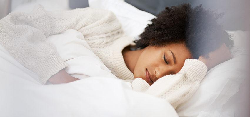 woman sleeping on comfy bed
