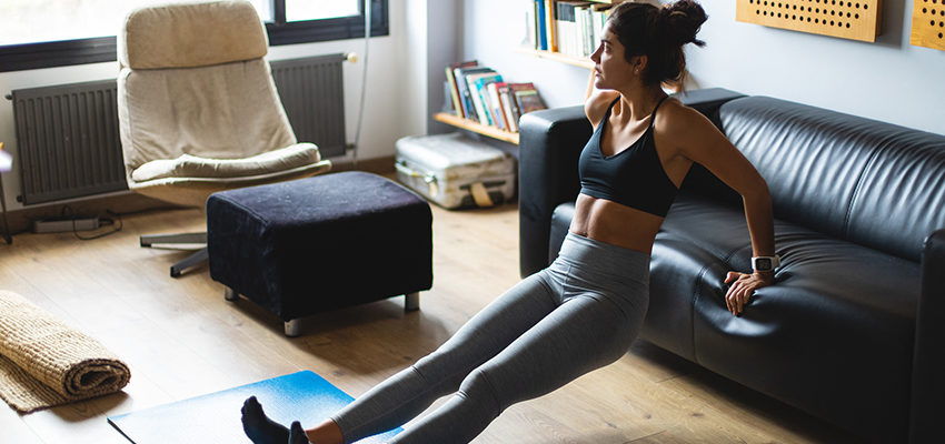 woman squatting using couch