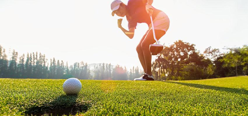 woman long putting golf ball