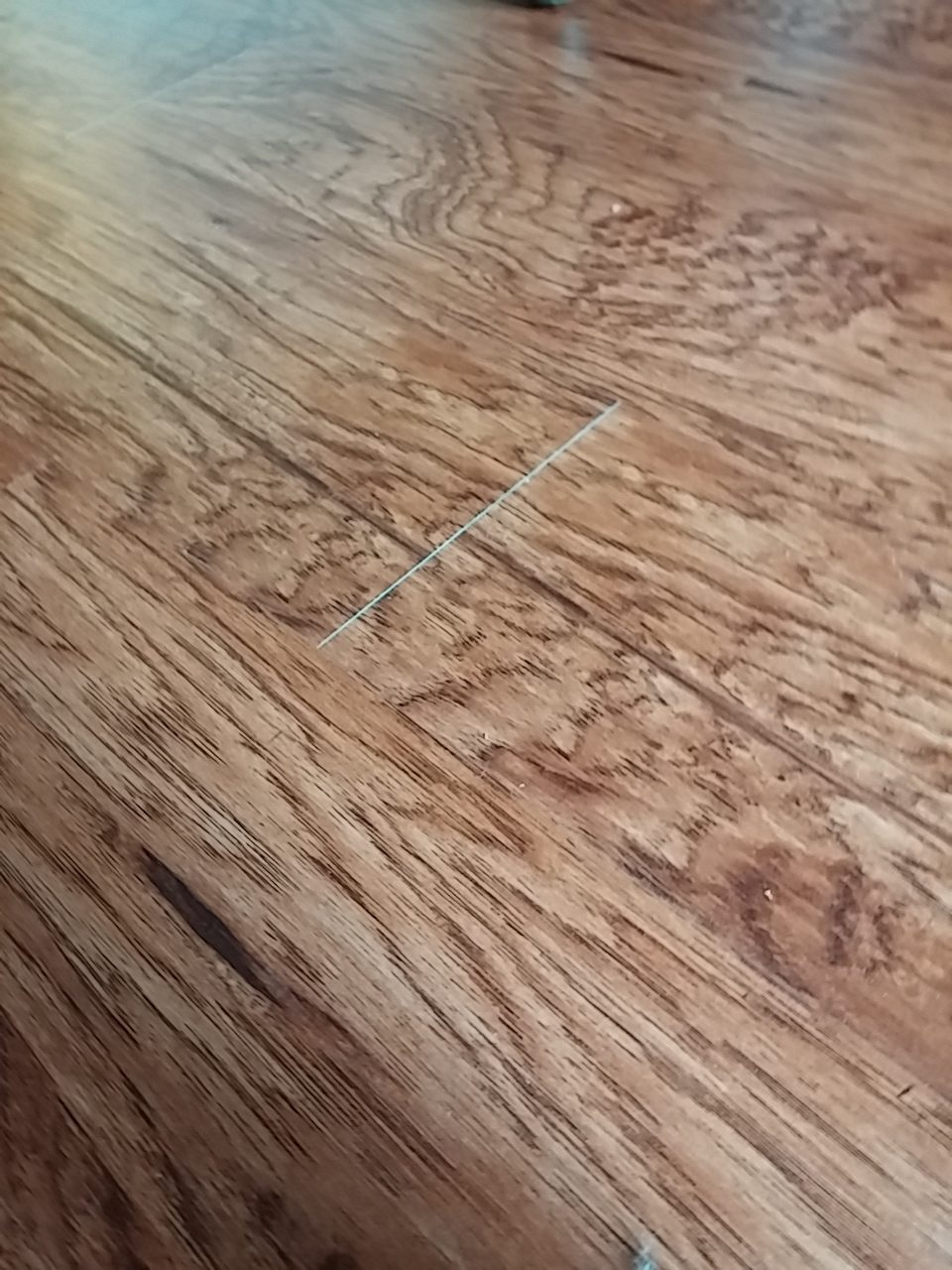 Home Depot Laminate Flooring Installation gorgeous dark stain pergo floor with granite kitchen countertop On 101015 I Paid Home Depot 496155 To Install New Floors On The First Level Of My Home On The First Day Of Installation I Notice The Installation Was