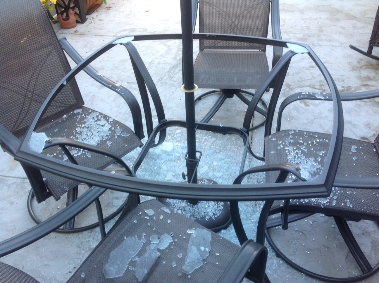 Glass patio table rectangular - Early This Morning We Found The Glass Tabletop Of Our Patio Table Shattered Into Thousands Of Pieces We Initially Suspected Vandalism But Absolutely