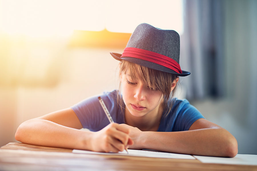 teen writing letter