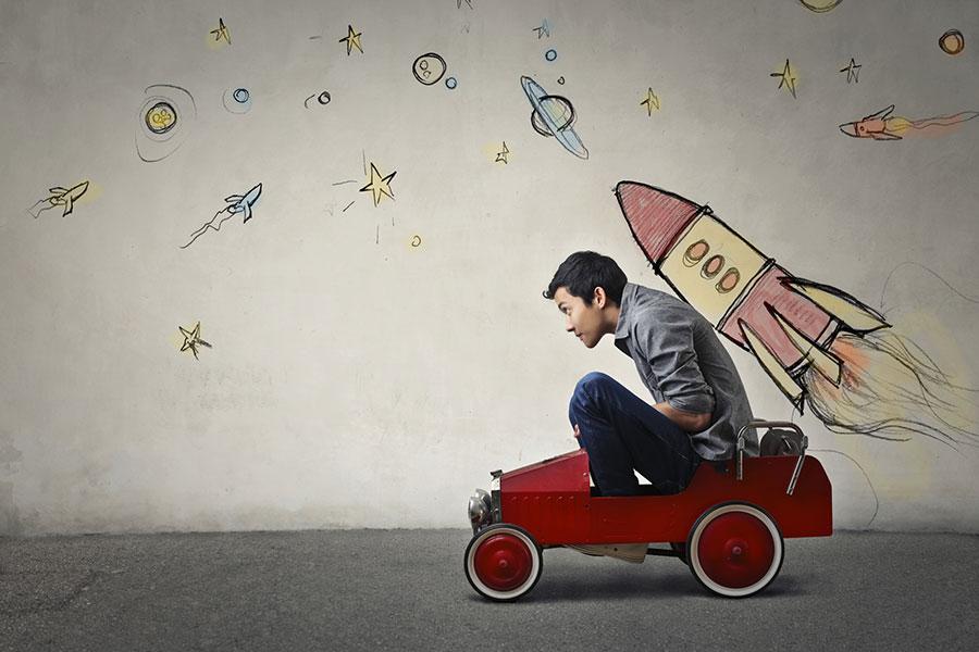 teen riding in rocket-wagon