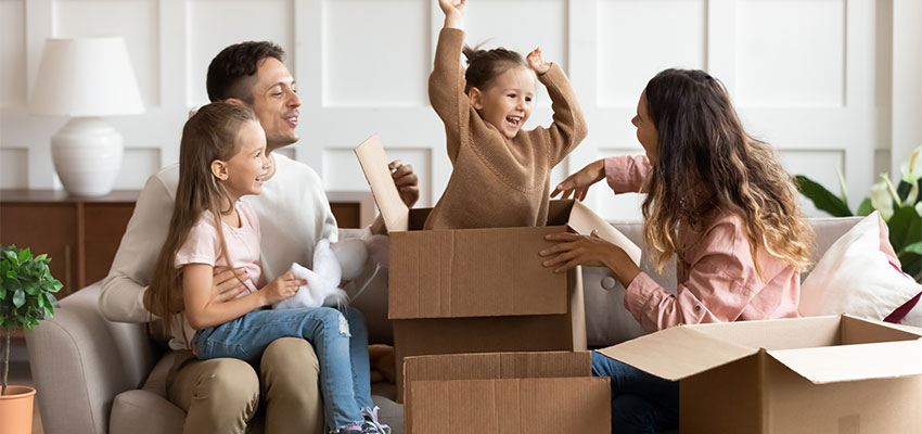 family sitting together with boxes