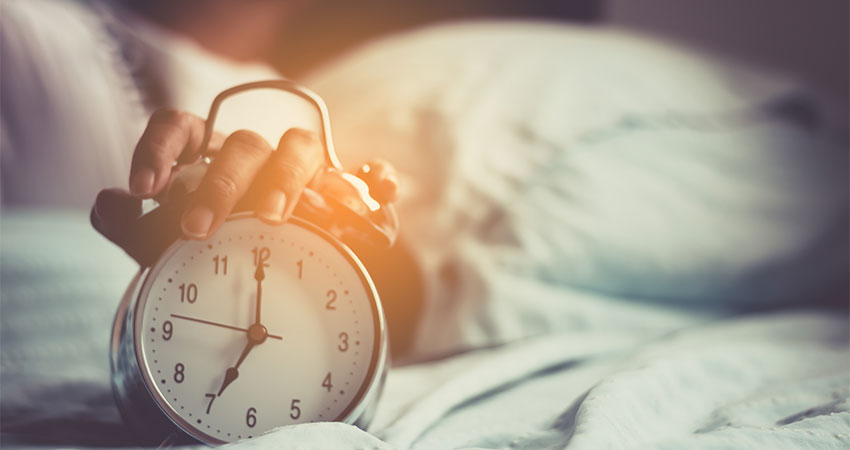 person setting alarm clock