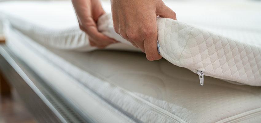 person looking at mattress